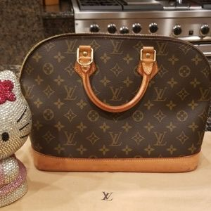 Louis Vuitton Monogram Alma Handbag